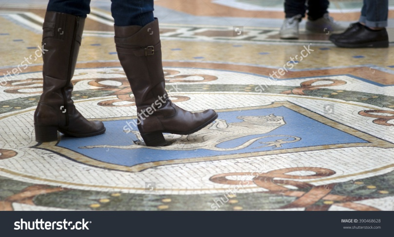 stock-photo-milan-italy-march-mosaic-floor-of-vittorio-emanuele-gallery-in-milan-tourist-using-the-390468628
